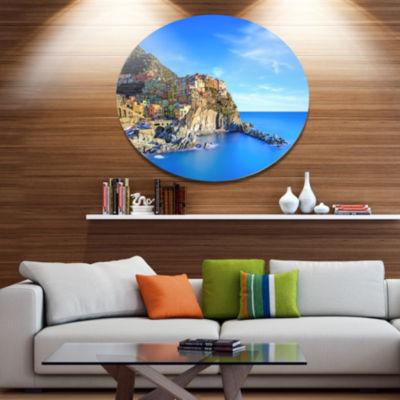 Designart Manarola Village in Rocks and Sea BeachPhoto Metal Circle Wall Art