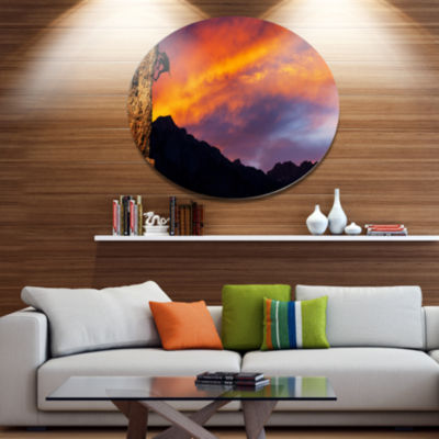 Designart Climber on Sunset Background Extra LargeLandscape Metal Circle Wall Art