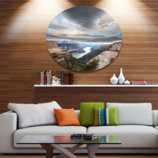 Designart Norway Rocky Terrains under Clouds BeachPhoto Metal Circle Wall Art