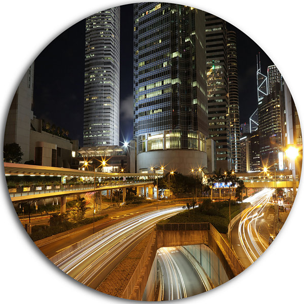 Designart Skyscrapers and Busy Traffic CityscapeMetal Circle Wall Art
