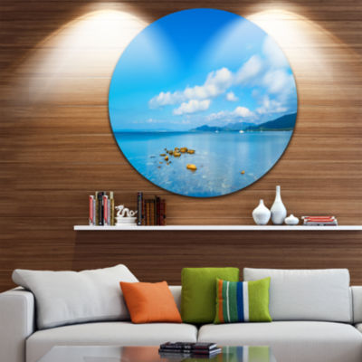 Designart Rocks in a Blue Panoramic Sea Bay ExtraLarge Seashore Metal Circle Wall Art