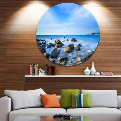 Designart Baratti Bay Rocks in Waters at Sunset Extra Large Seashore Metal Circle Wall Art