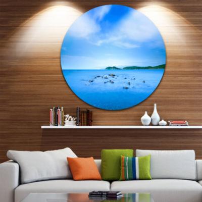 Designart Baratti Bay Small Rocks in Blue Sea Extra Large Seashore Metal Circle Wall Art