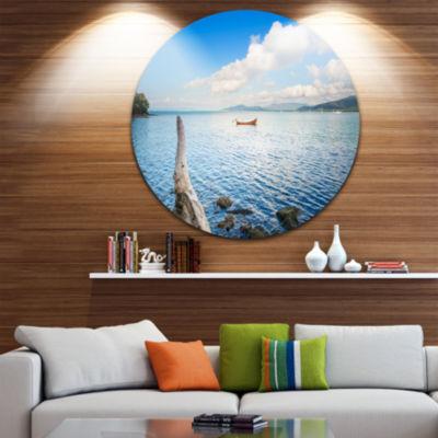 Designart Small Wooden Boat and Tree Trunk ExtraLarge Seashore Metal Circle Wall Art