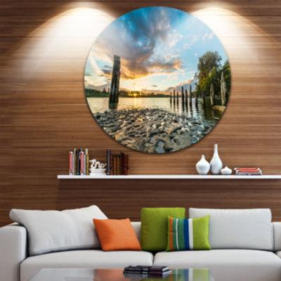 Designart Riverside Sunset with Wood Seascape Metal Artwork