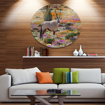 Designart Beautiful Oryx in Flower Field African Metal Circle Wall Art Print