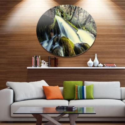 Designart Waterfall in Forest on Rocks Seashore Metal Circle Wall Art