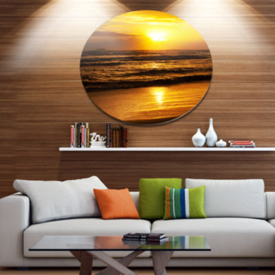 Designart Bright Yellow Sunset over Dark Sea BeachPhoto Metal Circle Wall Art