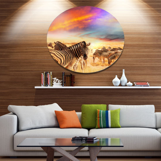 Designart Zebra Herd under Colorful Sunset Sky Animal Metal Circle Wall Art