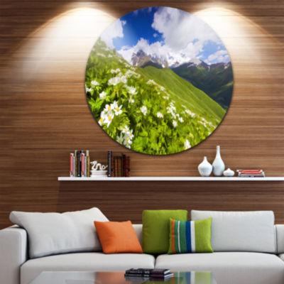 Designart Blossom Flowers in Mountains LandscapeMetal Circle Wall Art