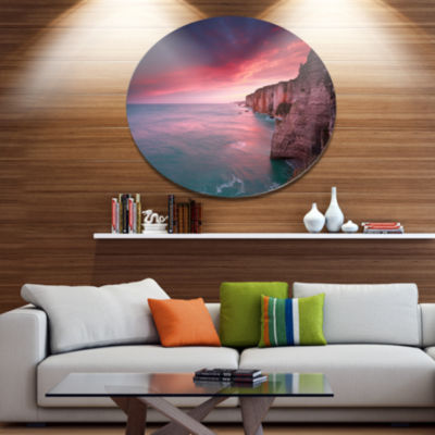 Designart Dramatic Sunrise over Sea and Cliffs Beach Photo Metal Circle Wall Art
