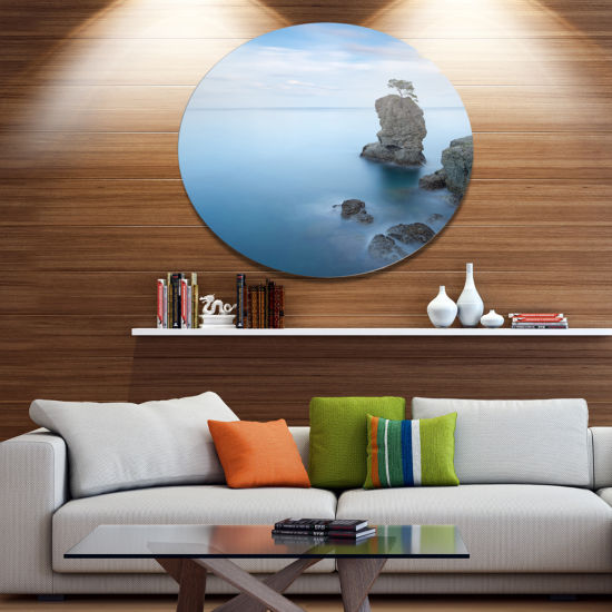 Designart Pine Tree Rock At Portofino Park Beach Photo Metal Circle Wall Art