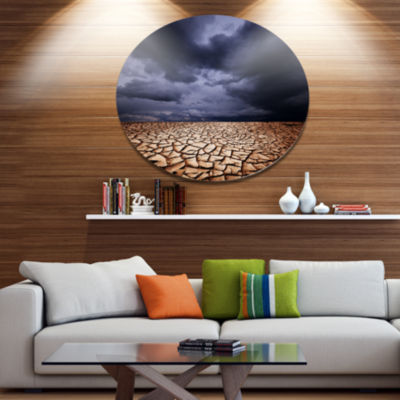 Designart Dramatic Cloudy Sky over Drought Land Extra Large Landscape Metal Circle Wall Art