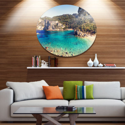 Designart Rocky Beach with Turquoise Water Beach Photo Metal Circle Wall Art