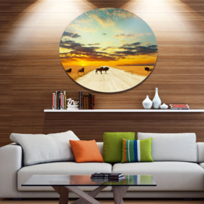 Designart Wildebeests Crossing Path in Evening African Landscape Oversized Metal Circle Wall Art