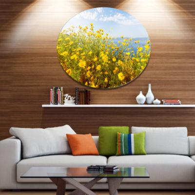 Designart Little Yellow Flowers over Seashore Large Flower Oversized Metal Circle Wall Art