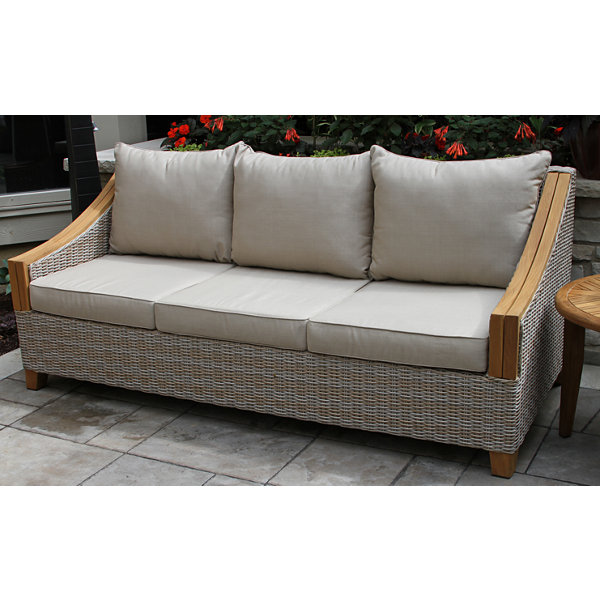 Great Outdoor Interiors Wicker And Natural Teak Sofa With Sunbrella Pillows And  Cushions