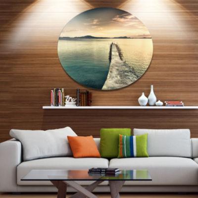 Designart Sea Bridge into the Deep Ocean Bridge Metal Circle Wall Art