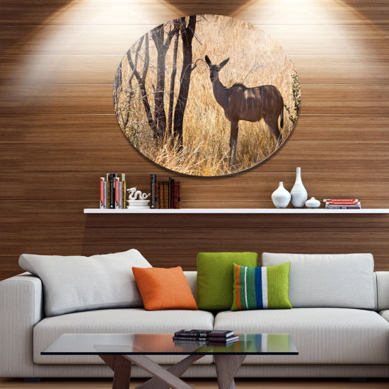 Designart Grants Gazelle Standing in Long Grass Animal Metal Circle Wall Art