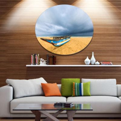 Designart Fishing Boat On Beach with Dark Clouds Large Seashore Metal Circle Wall Art