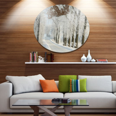 Designart Winter Rural Road Among Frosted Trees Forest Metal Circle Wall Art