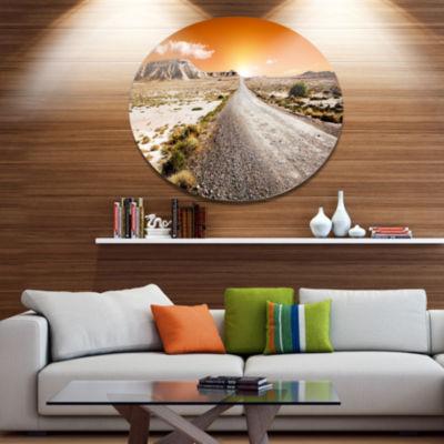 Designart Sunset Desert with Pebble Road LandscapeMetal Circle Wall Art