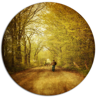 Designart Man Walking Lonely on Rural Road Landscape Metal Circle Wall Art