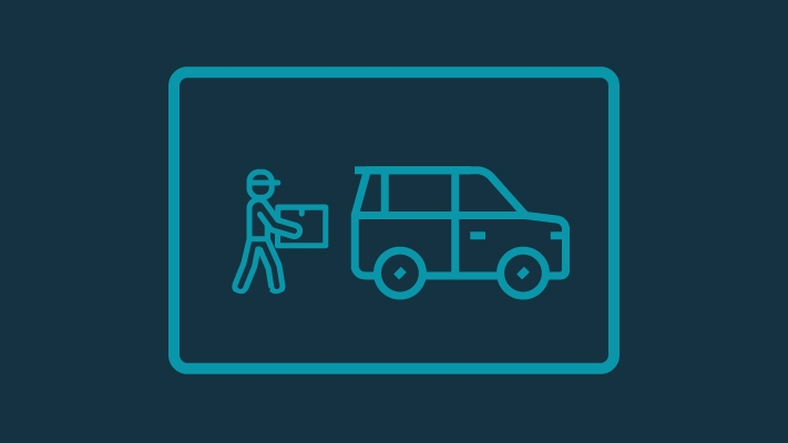 Person loading item into car icon