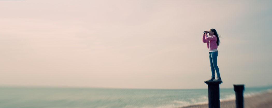 Woman looking into ocean