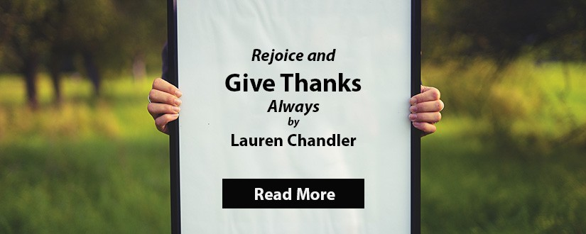 Person holding a give thanks sign