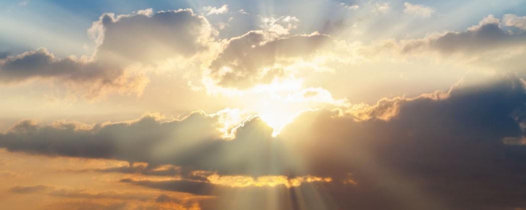 Sun rising through the clouds