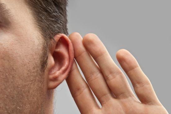 Man cupping ear to listen better.