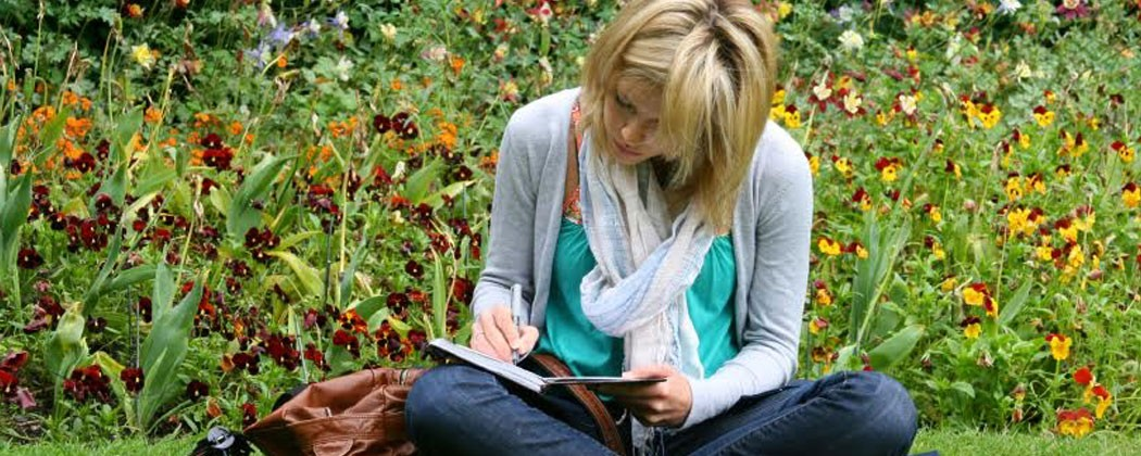 Woman reviewing notes outside