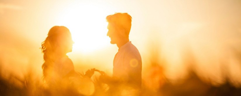 Couple standing in sunlight