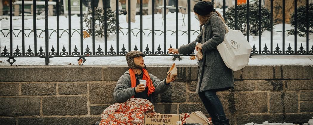 Woman giving a homeless man food