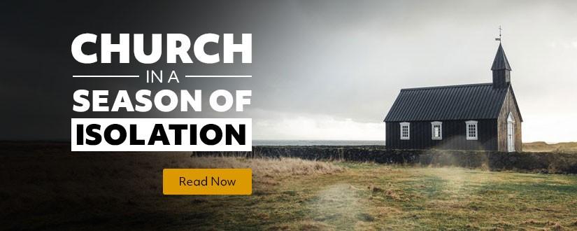 Church building standing alone in an open field