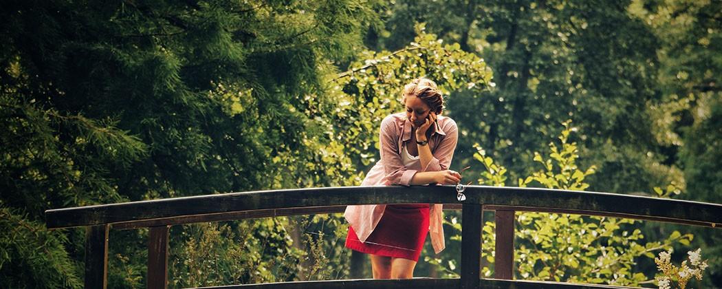 Women on small bridge overlooking a creek