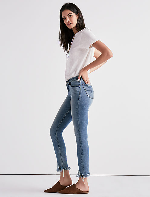 Lucky Lolita Mid Rise Skinny Jean With Fringed Hem