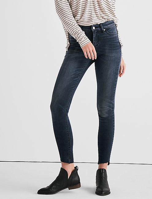 AVA MID RISE LEGGING JEAN WITH ASYMMETRICAL STEP HEM,