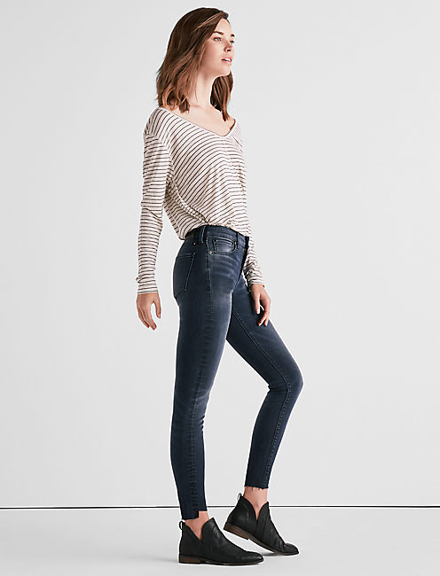 Lucky Ava Mid Rise Legging Jean With Asymmetrical Step Hem