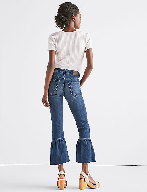 THE SHRUNKEN RUFFLE FLARE JEAN,