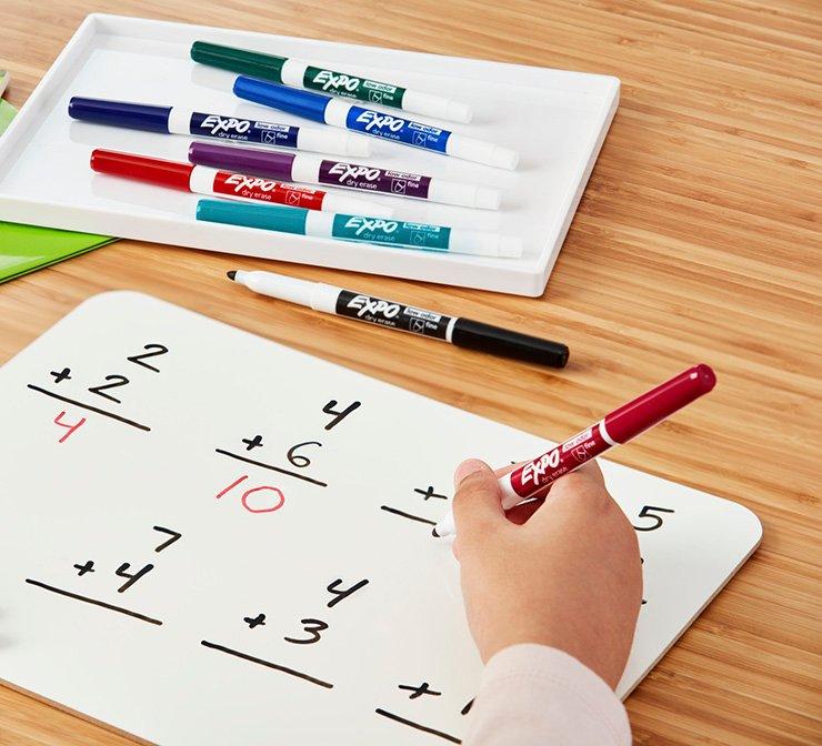 Dry erase marker in use for homework