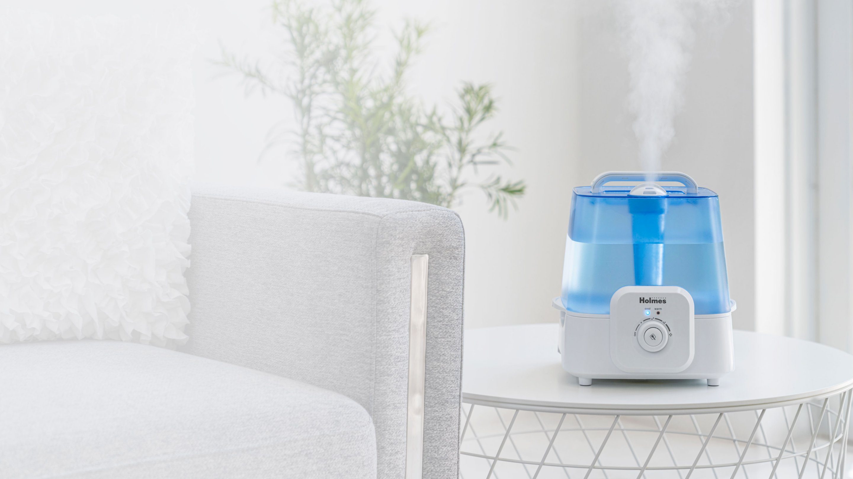 humidifier with cool and warm settings next to couch