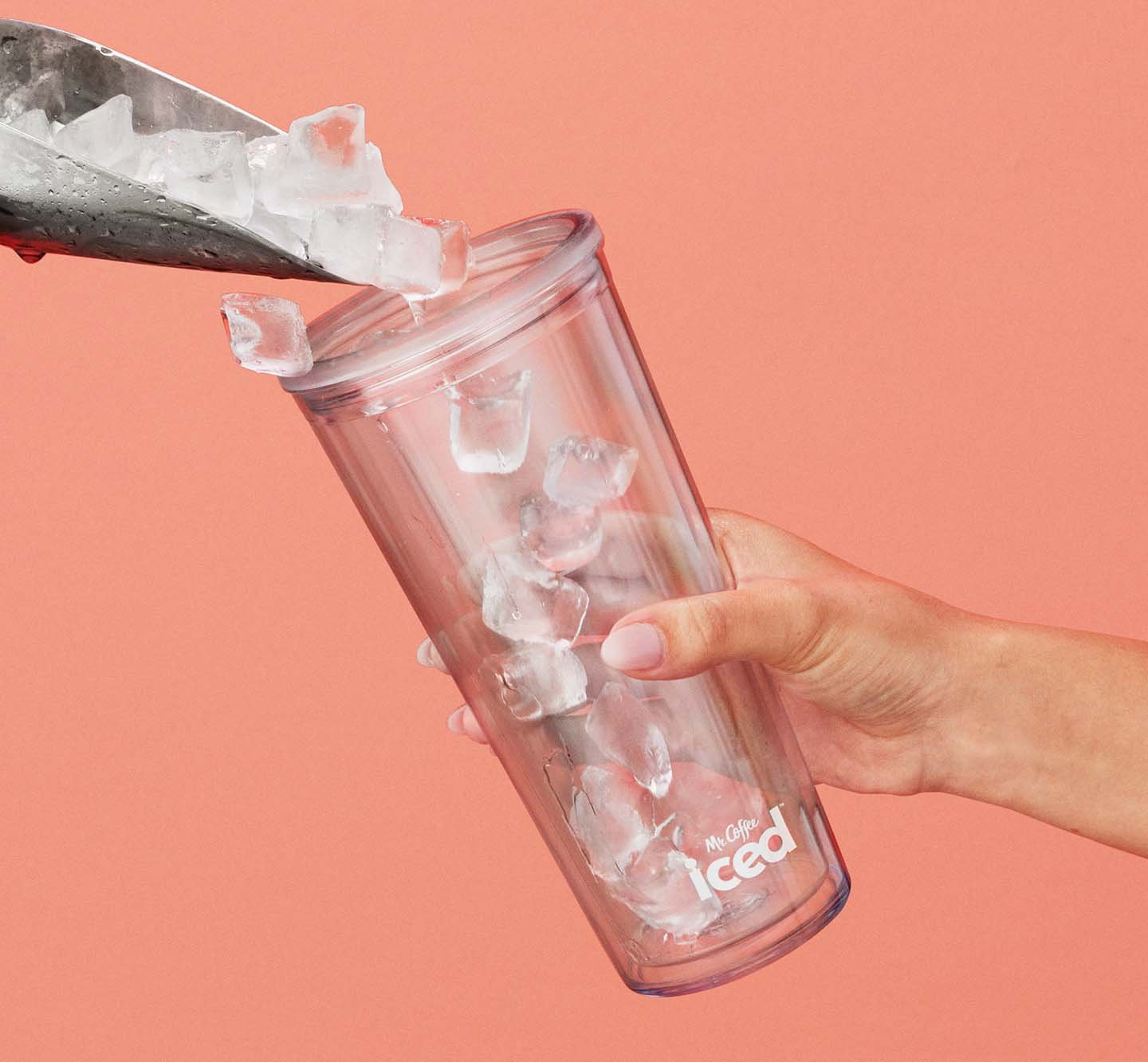 Putting ice into a cup