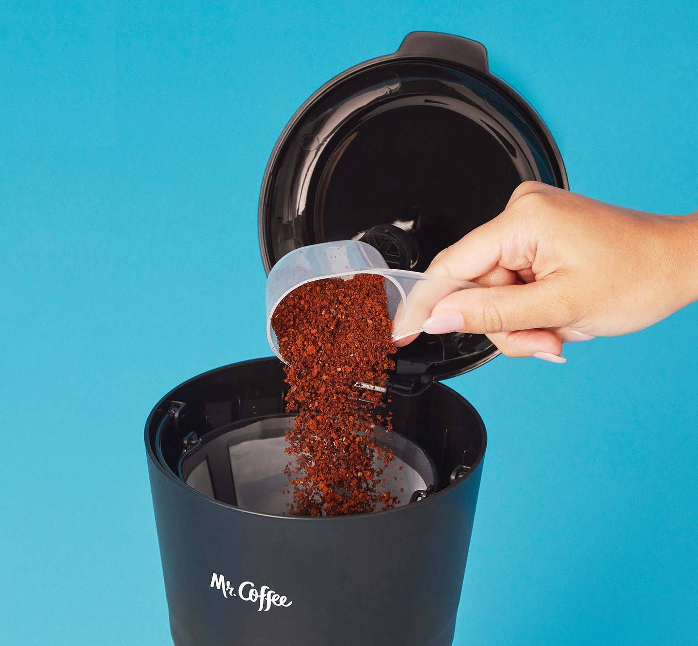 Putting coffee grounds into a coffeemaker