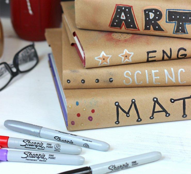 bookscoveredinbrownpaperwithsharpiedesignstile.jpg