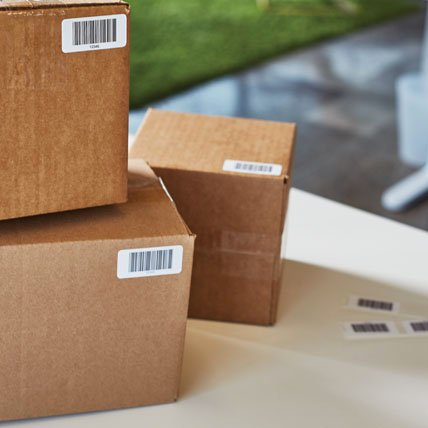 Stacked boxes with barcode labels.