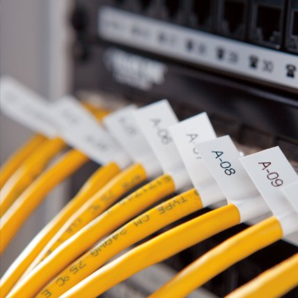 Labeled cables connected to a modem.