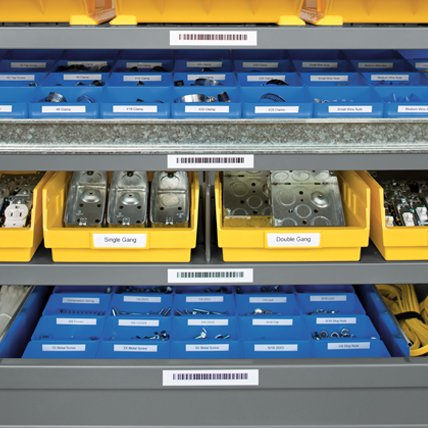 Labeled bins of electrical products on shelves with barcode labels.