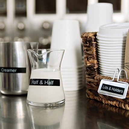 A labeled coffee station.